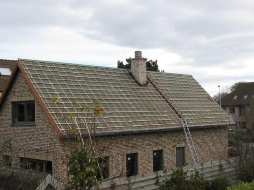 Nog hier en daar een dakpan leggen en een paar veluxen steken...