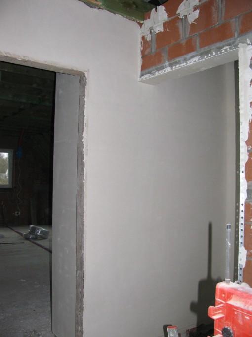 Muur in de traphal boven